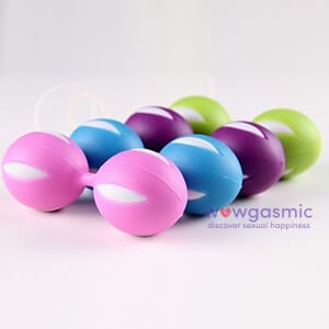 Side view Photo of pink, blue, purple and green silicon kegel balls next to each other- wowgasmic sex toys in Kenya for Sale